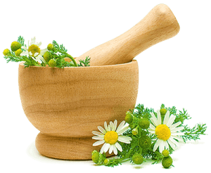 Деревянная ступа и цветки ромашки